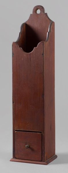 "ADA Online Show 6/8/16.   ""Pipe Box"" Description: New England, probably Connecticut, ca 1770-1790. Cherry, white pine secondary.  Having a wonderful elongated body with a shaped back fitted with a dovetail drawer. Condition: Fine, minor restoration, early red-wash varnish finish.   Dealer:	Jeffrey Tillou Antiques.  Date:	ca 1770-1790. Measurements:	21 3/4"" x 5 1/2""w x 4 3/4""d.  Price	$3,750."