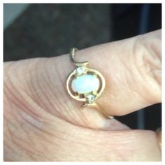 Mom's engagement ring. Simple opal and diamonds.
