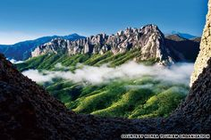 """Ulsanbawi (peak) in Seoraksan National Park - photo from Korea Tourism Organization; """"This [2.5 mile] long granite spine on 5,603 feet high Seoraksan's Ulsanbawi is no ... stroll in the woods.  The final section of the hike 'ascends a steel staircase screwed into the sheer granite cliffs.'"""" Seoraksan is the third highest mountain in South Korea."""