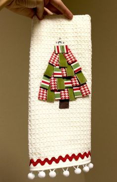 Hostess Gift Ideas: Decorative dish towels are a popular hostess gift this time of year. Give a plain white towel festive style by adding a ribbon Christmas tree and some decorative trim to it. It's very easy to do! Ribbon Trim Christmas Tree Hand Towel Tutorial