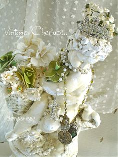 Chippy Shabby - Cherub statue decorated with vintage jewelry and flowers