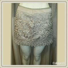 """Sans Souci Lace Mini Skirt From smoke free home.  Skirt has several lace layers over a tan lining.  Side zipper with hook & eye closure.  Super cute & sexy. Made of 100% polyester.  32"""" waist. Sans Souci Skirts Mini"""