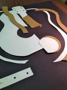 Collagraph low-relief shapes cut out of cardboard