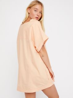Throw it on Tunic | Lightweight and oversized poplin tunic featured in a boxy silhouette.    * Semi-sheer   * Short sleeves * Hip pockets  **Styling Tip:** This versatile top can also be worn as a super mini dress. For a no-show look layer with one of our seamless shorts for an effortless look.