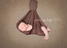 Baby newborn boy suspended in cloth hanging Precious Baby Photography Angela Forker unique Fort Wayne New Haven Indiana