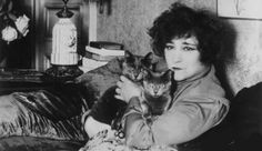 """From post (""""I heart kitty cats"""") --> """"When I think of famous peeps and cats I always think of Colette that famous French, Parisian writer..."""" -- Me: Colette and gorgeous cats pictured here, but all I can think of when I see her is Jack Lemmon in drag!"""