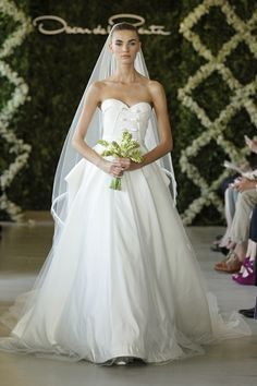 Oscar de La Renta came out with a new twist on wedding gowns. In love with the bodice.