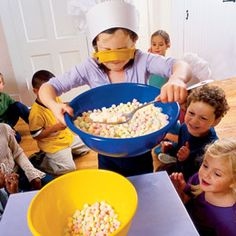 """""""Blindfold the Cook""""--Give one child a large spoon, a bowl of marshmallows and a blindfold. Set a kitchen timer for 1 minute, in which the child has to try and scoop as many marshmallows as possible into another bowl.  When the timer dings, tally up the marshmallows and let the next guest take a turn. Once the champion scooper is crowned, everyone gets to eat the marshmallows! :)"""