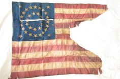 Thirty-four stars in a double wreath medallion, a forked swallowtail guidon battle flag of the Seventh Pennsylvania, witness to almost every campaign of Company F, from June 1862 to November 1864, including major battles in the state of Georgia: Marietta, Kennesaw, Powder Springs, Chattahoochee, Covington, Jonesboro, et.al. Length 35.5 Height 25.5