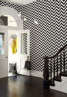 monochrome chevron zig zag wallpaper in the hallway - wow!