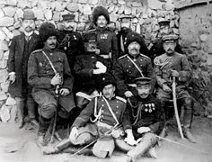 General Nogi is seated in the center next to Russian general Anatoly Stessel after Russian forces surrendered at Port Arthur on 2 January 1905.  After the fall of Port Arthur, Nogi was regarded as a national hero. He led his 3rd Army against the Russian forces at the final Battle of Mukden, ending the land combat phase of operations of the war.