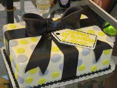 present birthday cake, polka dots with bow and tag