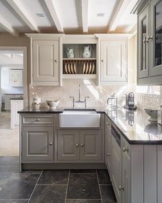A Classic Style Kitchen at our Oak Farm showroom. The ceramic Belfast sink enhances the traditional feel.