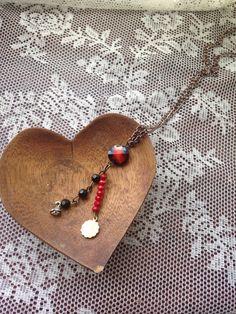 Capricorn garnet astrology necklace on Etsy, $32.00