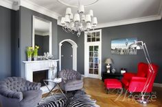 This is the exact color scheme I am using and doing in my living room.. Red love seats, dk grey walls and white mantel, shelves and crown molding.  I love it! Anne
