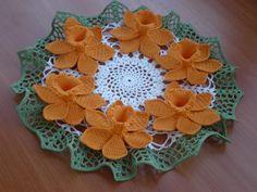 https://flic.kr/p/76cDuP   Daffodil Doily by Agnes Russell   Daffodil Doily by Agnes Russell/Crochet World April 1994 Doily-23cm, daffodil-8 cm/hook 1.00 DMC Babylo size 10 268m/50gr(orange), Madame Tricote Maxi 565m/100gr (white), Anna 16 530m/100gr (green) finished 04.2009 PA100331