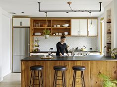 """i love the look of this, way everything fits together and the way it's framed, the """"blockiness"""" and natural but clean feel. the townhouse kitchen is the same shape kitchen as ours, also.    Greenpoint Townhouse - WE Design 