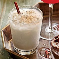 Holiday Milk Punch | This drink creates a sense of holiday coziness with fresh nutmeg. | SouthernLiving.com