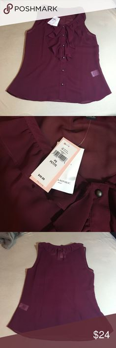 NWT maroon banana republic blouse This is perfect for a work event, or to wear under a suit jacket. It is very flattering and has gorgeous ruffles and buttons on the front. New with tags and comes with an extra button. It is a small petite. I ❤️ offers! Banana Republic Tops Blouses