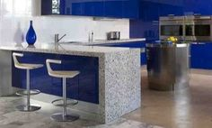 Cobalt Skyy- Vetrazzo Recycled Glass Countertops »  I love the drama and story of these recycled glass countertops from Vetrazzo. Each top is made from Skyy's signature blue vodka bottles.    In this high-drama kitchen, the glossy blue cabinets steal the show, but you could just as easily pair these Cobalt Skyy tops with natural maple to let them star on their own.