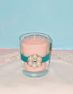 Teal Wedding / Wedding Votive Candle by CarolesWeddingWhimsy, Set of 6, Teal Wedding Votive Candle Holder with Pearl and Rhinestone Brooch.  They are perfect for any wedding, but especially for a beach wedding, destination wedding, bridal shower decor, baby shower decor.  They can be found here https://www.etsy.com/listing/128548813/teal-wedding-wedding-votive-candle