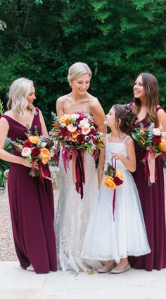 Lovely berry hues and greenery! The bride is wearing Nola by #MaggieSottero, a priority style with a short delivery date! PC: Penelope L'amore Photography. #Maggiebride #shortdeliverydate #bridesmaids #jeweltones #bridalbouquets