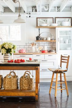 Fixing the kitchen proved inexpensive, thanks to subway tiles and plenty of white paint, and a few bargains.