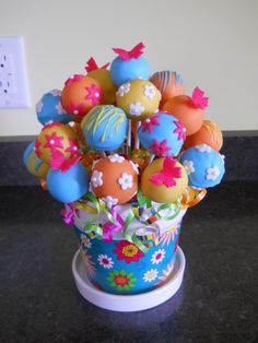 Love this idea for a little girls birthday :) Instead of flower centerpieces - cakepop flower bouquets! Fab idea for garden theme party