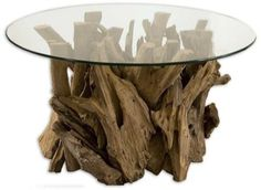 Uttermost Driftwood Glass Top Cocktail Table by Uttermost. $723.80. Dramatically constricted of natural driftwood, this cocktail table by Uttermost features a clear glass top. Create visual interest in your home decor with this stunning table design.. Save 51%!