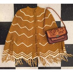 """Perfect day for wearing ponchos!  1970s mustard knit/ shoulders 18"""" waist 56"""" fits most sizes $40 Mexican tooled leather bag $36  comment with email and zip to purchase"""
