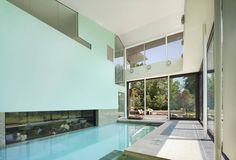 Современный двухэтажный дом с большим крытым бассейном