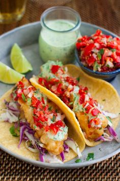 Beer Battered Fish Tacos with Cilantro-Lime Sauce - Crispy fish, crunchy slaw, fresh pico de gallo, and a zesty cilantro-lime sauce make for some super tasty baja-style fish tacos.