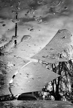 Very creative black and white image.  Disordered photograph with an incredible reflection effect.  Genius.