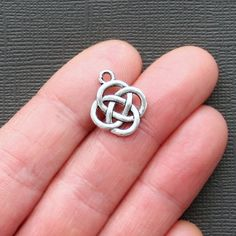 10 Celtic Knot Charms Antique Tibetan Silver Tone 2 Sided Simple yet Classic - SC506. $2.50, via Etsy.