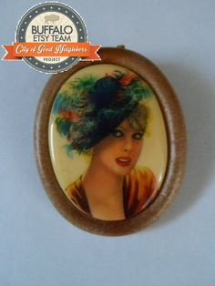 Unique Plastic West Germany Cameo Pin with Faux Wood Frame    100% of the sale of this item is being donated in support of a Buffalo veteran and