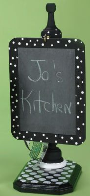 My new love is chalboard paint. I will have to make one of these for sure!