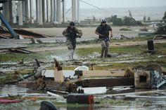 Air Force pararescueman  search a flooded portion of Galveston, Texas by simminch, via Flickr