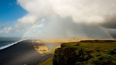 As the weather shifts in the southern tip of Iceland, the clouds part to give way to a perfect rainbow.