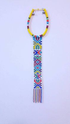 Handmade Ndebele beeded necktie that can be worn by both sexes African Beads Necklace, African Jewelry, Bead Jewellery, Beaded Jewelry, Beading Patterns, Embroidery Patterns, Xhosa Attire, African Accessories, African Wedding Dress