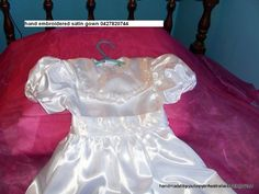 hand embroidered like previous gown in white satin 0427820744