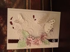 Hand made by Rita Pirc, embossed with flowers and butterflies.