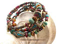 Tibet. Czech Picasso glass, Coral, Turquoise, Brass, Tibetan memory wire bracelet.