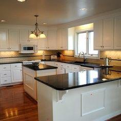 Kitchen Remodel with Peacock Granite, Ceramic Backsplash and Hardwood Floors by Hatchett Design/Remodel