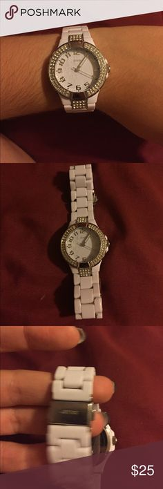 guess watch White guess watch, shows wear! There is slight scratching on the front face. Needs a new battery-- can be purchased at Macy's. Price reflects condition!! Will accept reasonable offers Guess Jewelry Bracelets