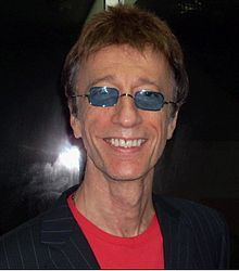 Robin Hugh Gibb, CBE (22 December 1949 – 20 May 2012) was a British singer and songwriter. He is best known as a member of the Bee Gees, co-founded with his twin brother Maurice and older brother Barry. He had another younger brother, Andy Gibb, who was also a very popular singer.