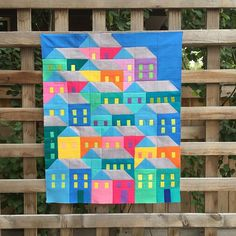 SnapWidget   A sweet little hillside of houses made with scraps from my gravity quilt. Designed by @prettylittlequilts. Only 15 by 19 inches. How to quilt??? #hillsidehousesqal