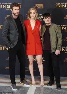 All stars: She cosied up for snaps with her co-stars (right) Josh Hutcherson and Liam Hems...