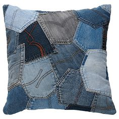 The front of this vintage style cushion is made of a patchwork of denim pockets, giving it an individual look. Mix things up with a variety of colours...