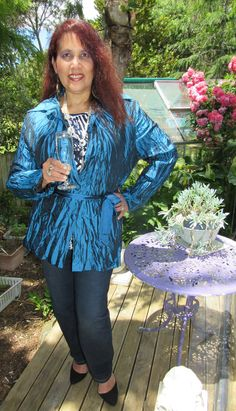 Jacqueline wears a crushed blue silk shirt/jacket by Millers -Beautiful colour for evening wear