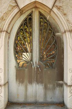 Rock Creek Cemetery - Gothic arch doors to mausoleum by tiz_herself, via Flickr